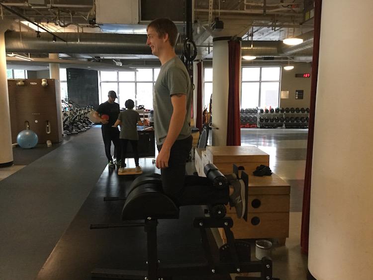 Jordan demonstrates the hamstring curl, position 1. Jordan Sahlberg is a trainer at ZUM Fitness.