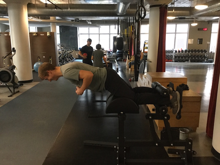 Jordan demonstrates the hamstring curl, position 2. Jordan Sahlberg is a trainer at ZUM Fitness.