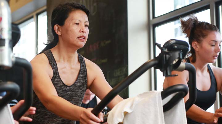 Modern cardio equipment at ZUM Fitness includes bikes, treadmills, step machines,